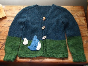 blue and green sweater with two small totoros.