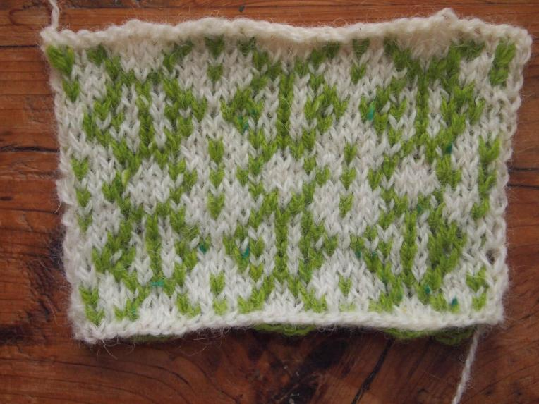 A swatch of stranded knitting based on the word Spring encoded as numbers.
