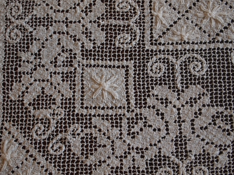 A section of a lacis (filet lace) tablecloth.