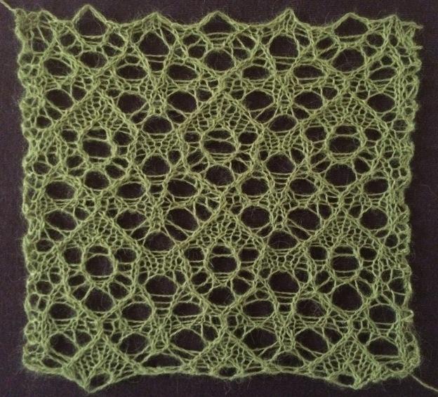 Fruitbat encoded as a lace knitting stitch.