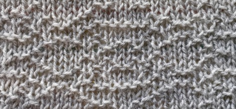 Mountain: a knit-purl stitch pattern based on encoding the word as numbers.