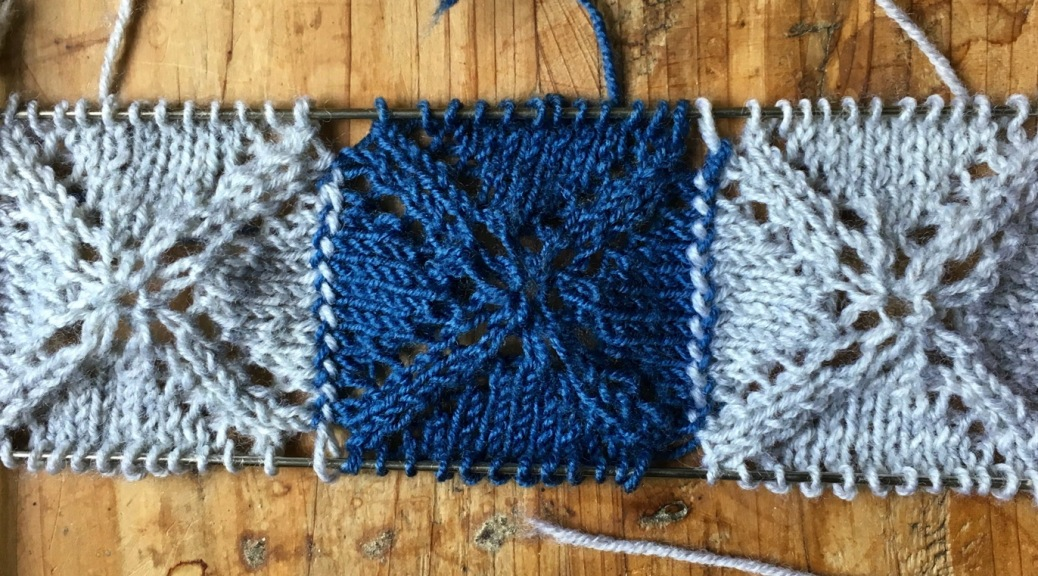 Knitted squares attached to each other with Russian grafting.