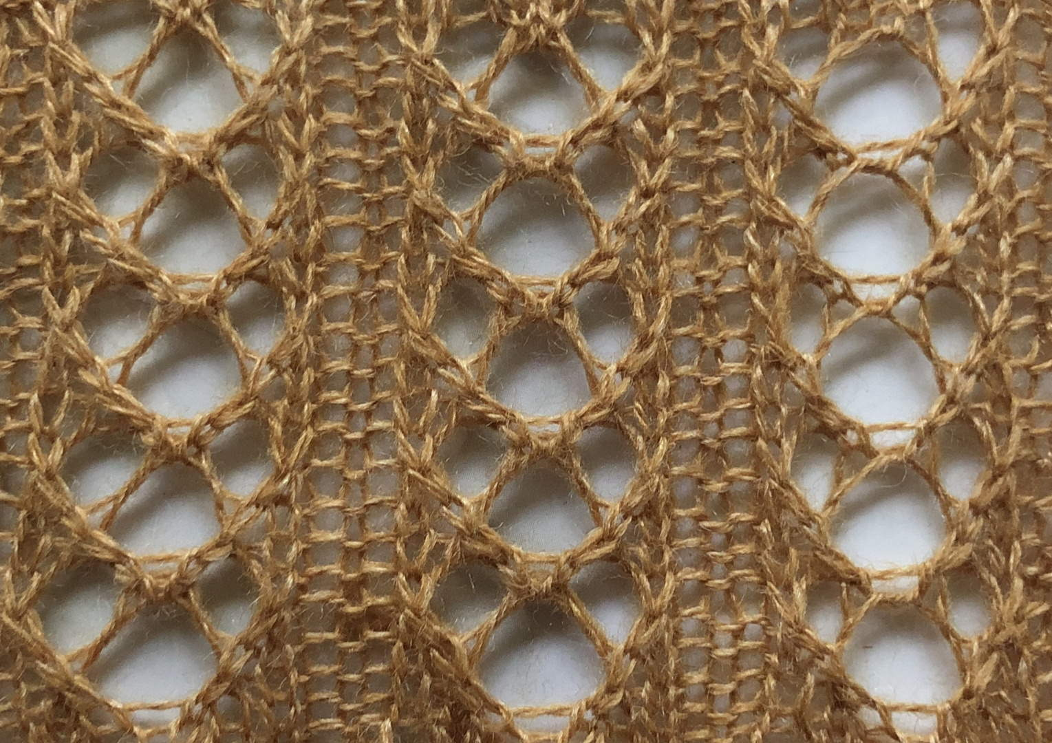 Lace Crescent Rib: a free lace knitting stitch pattern, by Naomi Parkhurst