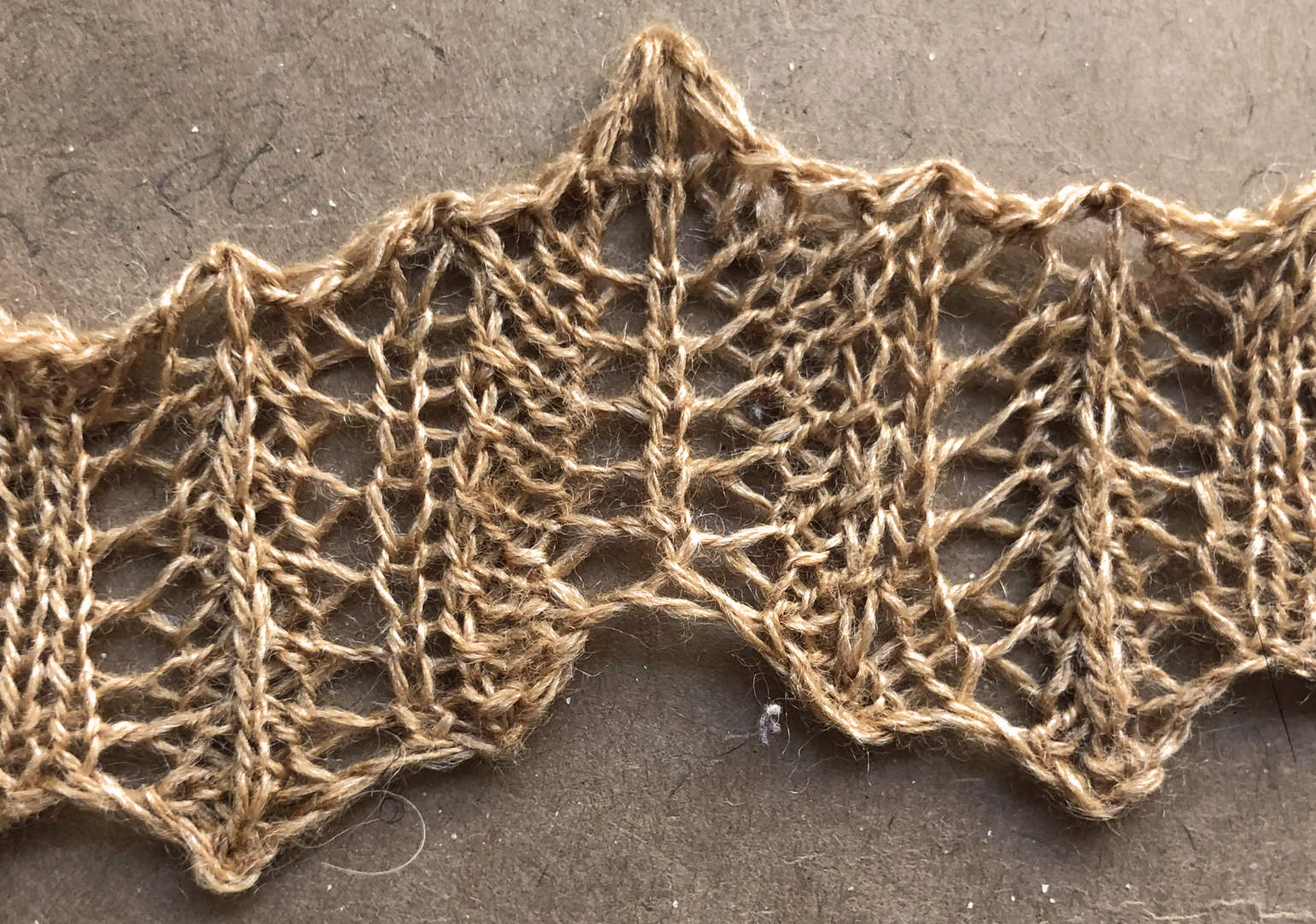 Rolled up v1: a free lace knitting stitch pattern.