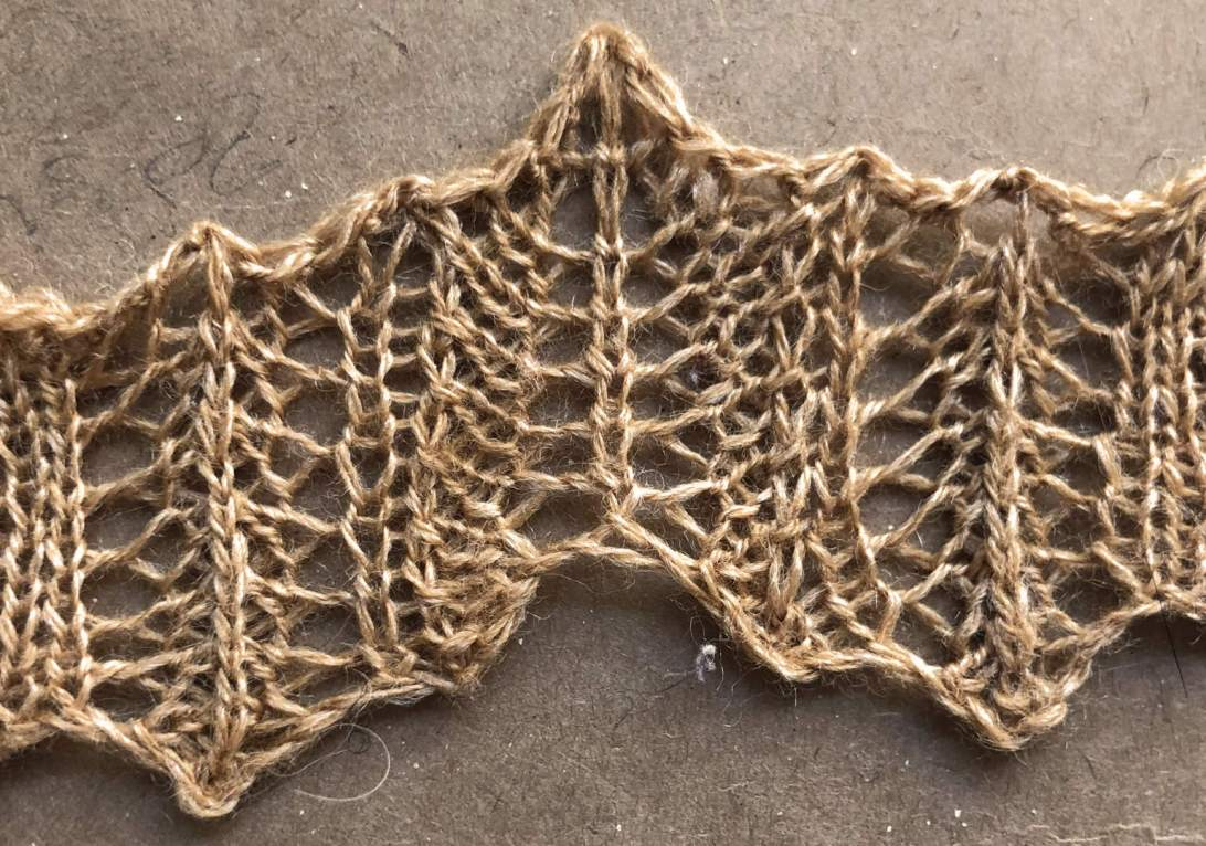 Rolled Up v1: a free lace knitting stitch pattern