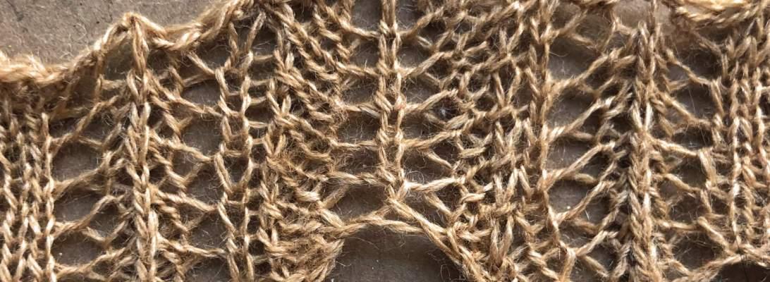 Rolled Up v1: a free lace knitting stitch pattern