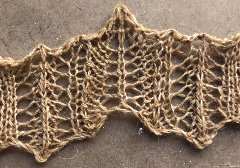 Rolled up v1: a free lace knitting stitch pattern.