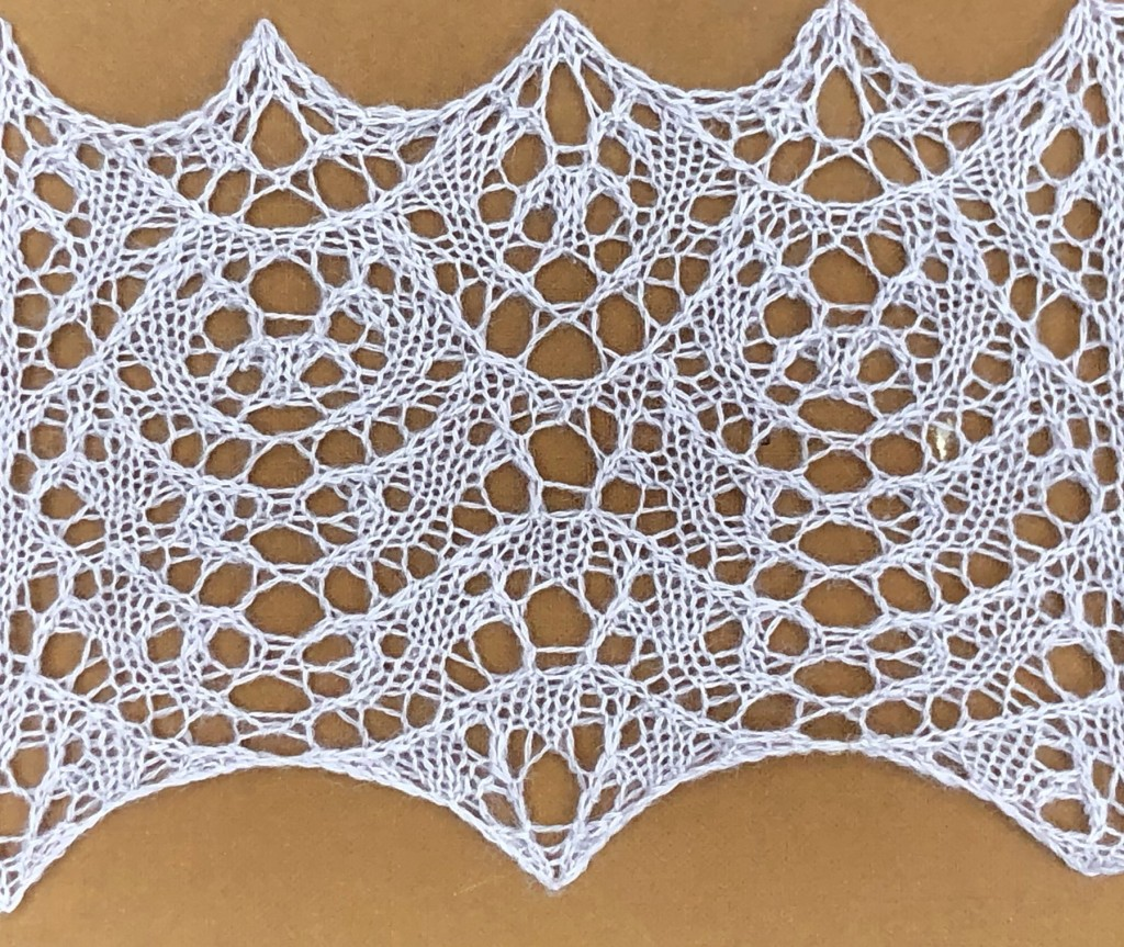 Creation: a lace knitting stitch pattern, by Naomi Parkhurst (photo of swatch)