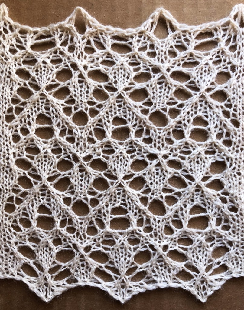 Vulture: a lace knitting stitch pattern, by Naomi Parkhurst (swatch photo)