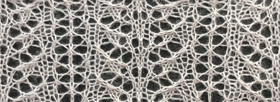 knitted sample for Snow: a lace knitting stitch pattern, by Naomi Parkhurst