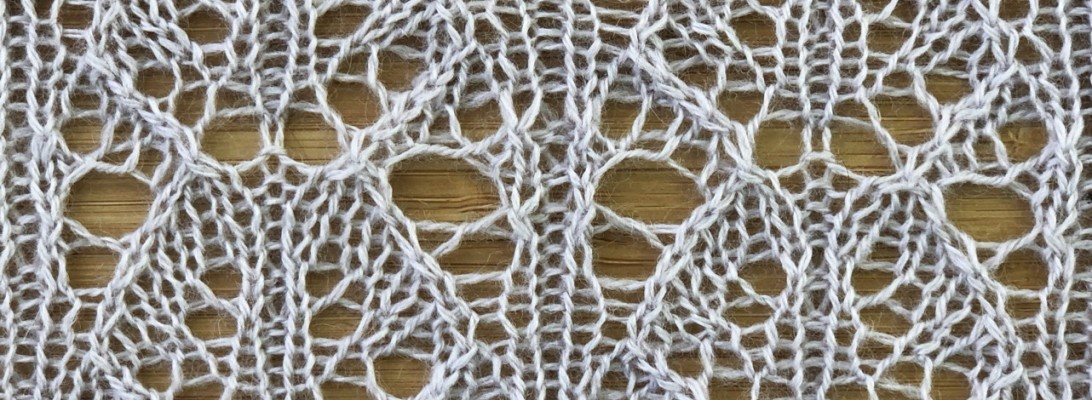 photo of sample swatch for Roses: a lace knitting stitch pattern, by Naomi Parkhurst