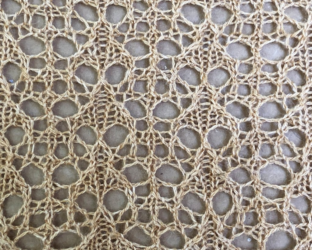 lace knitted from the chart below
