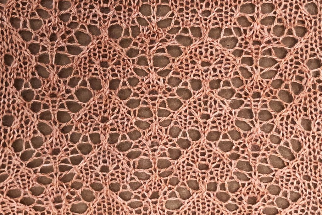 knitted sample for the lace for the word 'knit'