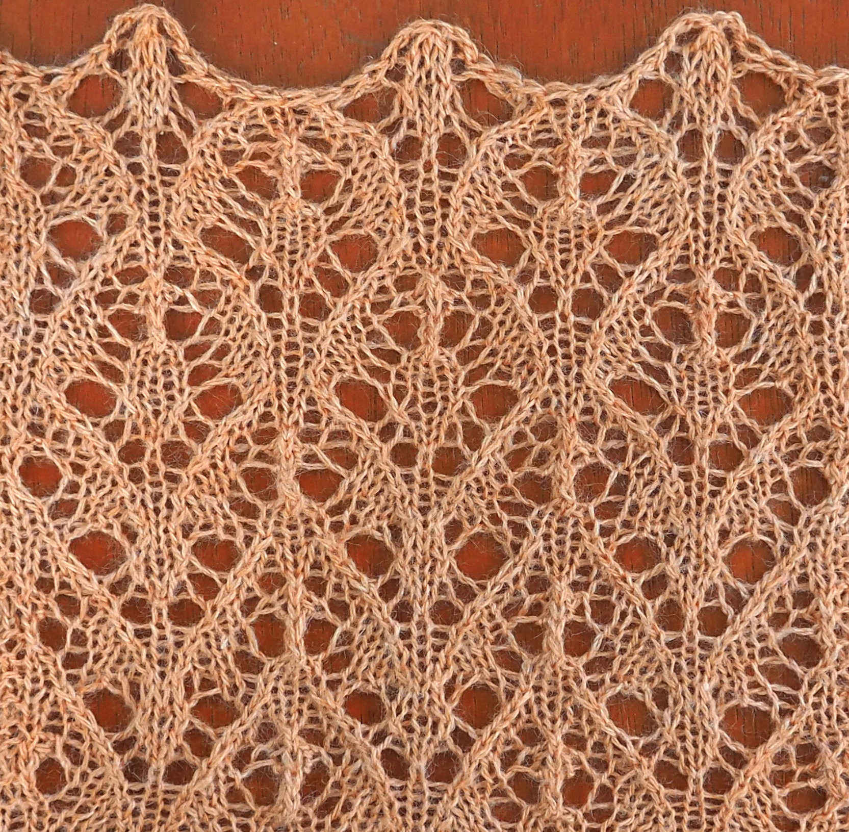 knitted sample of Verve lace; it's kind of like feathers. Written instructions are below.