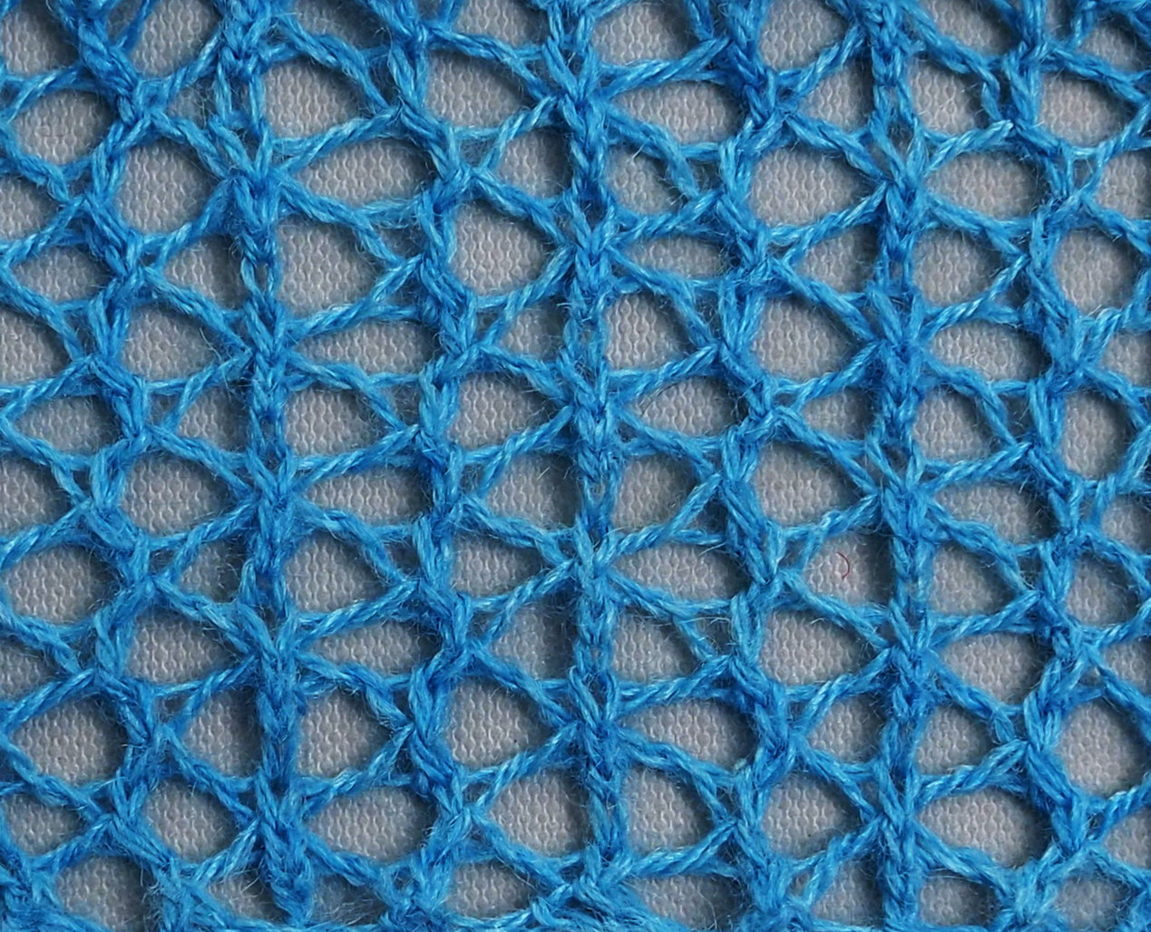 knitted sample of holiday mesh
