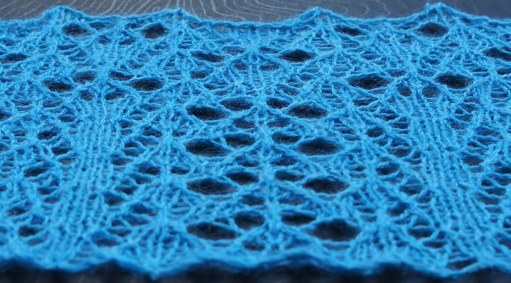 knitted sample of Query lace side view